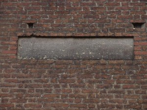 la lapide del 1266 sul campanile della Cattedrale
